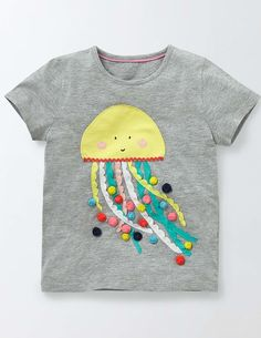 Oh, we do like to be beside the seasiiiide! And so does this pure-cotton jersey T-shirt. Choose from a host of characterful appliqués, some of which feature nifty 3D and interactive details – from rickrack jellyfish tentacles to a donkey's suitcase you can look inside. All together now: holi-yay!