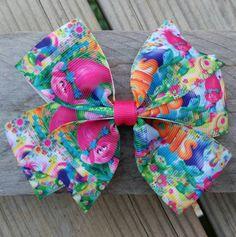 Trolls hair bow, Trolls bow, DreamWorks trolls hair bow, DreamWorks trolls, trolls, hair bows, bows, pinwheel hair bow by Bowtiquefun on Etsy https://www.etsy.com/listing/475638050/trolls-hair-bow-trolls-bow-dreamworks