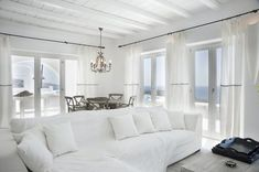 Clean White Living Room Sofa Furniture Of Greece Villa Island Sweet White Living Room With Curtains And Furniture Ideas Home Interior, Interior Decorating, Interior Design, Decorating Ideas, Luxury Interior, Interior Ideas, Myconos, Beautiful Villas, The Design Files
