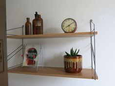 This shelving unit consists of two shelves and two metal uprights. The shelves and uprights are in good condition with some minor age related wear. Shop our full collection of Storage here at Vinterior Kingdom Of Great Britain, Floating Shelves, Mid Century, The Unit, Shelving, Vintage, Ebay, Living Room, Home Decor