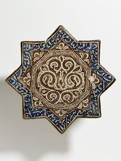 Tile.  Kashan, Iran.  Early 14th century.  Fritware, painted with lustre over the glaze.