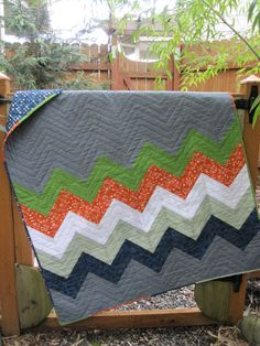 Like the idea of not the entire quilt being all striped, some how more masculine.