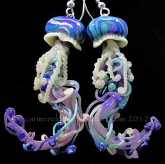 "jellyfish earrings. $18.00, via Etsy. Vibrant elegant earrings, hand sculpted in polymer clay, light weight, and easy to ware    the jellyfish hang from silver plate earring wires. jellyfish sculptures measure 2 inches long and 1 inch wide.    mini sculptures are coated with a shiny polymer clay gloss to give it that ""pulled from the ocean"" wet look.    jelly fish are durable polymer clay which has a unique flexibility that bends slightly and does not break easily.    glow in the dark"