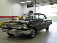1964 Ford Fairlane 500.  Paint it cream color, and it is like mom's old car.