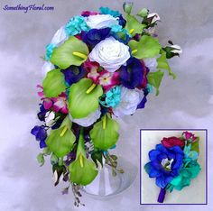 A realistic, artificial floral, crescent shaped, bridal bouquet created with chartreuse green calla lilies, deep periwinkle lisianthus, white roses, blue and red-violet hydrangea, aqua / Tiffany blue hyacinth, and purple, cobalt blue, and teal delphinium. A coordinating groom's boutonniere of delphinium and ranunculus buds. Design: Something Floral / Something Spectacular. Photo: Urban Fire Studio. #bridal #bouquet #wedding #flowers #crescent #cascade #groom #boutonniere #buttonhole