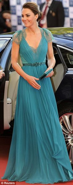 Kate Middleton in a teal belted dress at the Olympic gala concert. May, 2012.