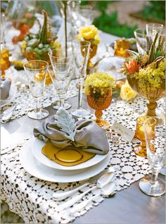 Use mixed amber glass pieces to decorate for Golden Anniversary reception. Oh, look! I already have a small collection! (Malibu Botanical Garden Photo Shoot on Style me Pretty by Krista Jon.)