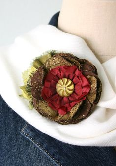 A red flower Christmas corsage ... The perfect holiday accessory to renew a cozy winter scarf or jacket and a unique Christmas gift for a friend