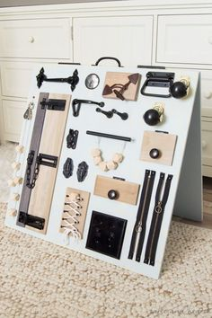 Keep your little one occupied while keeping your style too, check out this stylish rustic baby busy board from www.tableandhearth.com!
