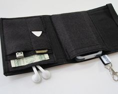Nerd Herder gadget wallet in Just Black for iPod, Droid, iPhone, MP3, metronome, digital camera, earbuds, SD cards, USB, guitar picks, IDs. $32.00, via Etsy. Other fabrics and colours available. Cool!