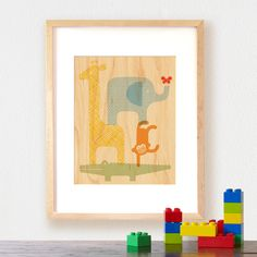 Petit Collage animal tower print on maple veneer. Available in two sizes, both sizes fit standard frames. Unframed print arrives matted and sealed in a glossy sleeve.