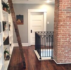 Exposed railings to lower level. Love floor and walls too
