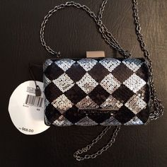 BCBG Clutch Minaudière Purse New with tags, message me if you have any questions or want to see more pictures. 6 in wide, 4 in tall, 3 in wide BCBG Bags