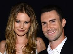 Could there be a new wedding trend on the horizon? Behati Prinsloo got her wedding ring tattooed, so I guess this means she'sreally committed to her husband, Adam Levine. And she's low-maintenace. So that makes her even cooler. Prinsloo decided to tattoo three dots on her left ring finger in lieu
