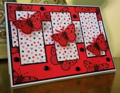 Hero Arts ... Triple Butterflys by pinkberry  ... die cut red butterflies on polka dot panels ... red background stamped with butterfles and covered with black jewels ... fun look!