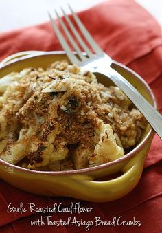 Garlic Roasted Cauliflower with Toasted Asiago Bread Crumbs - Cauliflower, tossed with a little olive oil, garlic, salt and pepper then roasted in the oven...YUM!