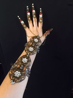 A personal favorite from my Etsy shop https://www.etsy.com/listing/479703987/claw-armor-bracelet-crystal-glove