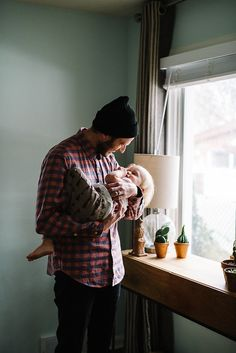Lifestyle family photos at home with dad and son.