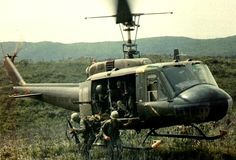 Soldiers exiting Huey Helicopter in Vietnam