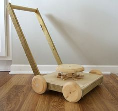 what an awesome homemade wooden lawn mower toy! click through to read about how it works (genius!) and read the post w/comments to learn about gender-based paint choices that the mom is struggling with for the toy.