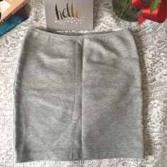 """American Apparel heather grey mini skirt Simple, stretchy mini skirt featuring smooth fabric and figure-hugging fit. In heather grey.  65% Polyester, 30% Rayon, 5% Spandex Striped Ponte construction  Small approximately 15 1/2"""" (39.37 cm) in total length  Elastic waist band   PayPal/MercLow Balling Trades  Price negotiable! Use the offer button! American Apparel Skirts Mini"""