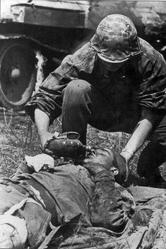 "m4a1-shermayne: ""Not every German soldier was a mass murdering heartless bastard. This Waffen SS soldier helps give water to a wounded Russian. """