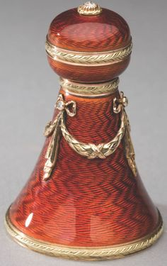 Fabergé scent bottle.  Workmaster Henrik Wigstrom. Rust guilloché enamel with gilt design.