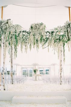 Stunning hanging floral ceremony decor: http://www.stylemepretty.com/2016/03/28/a-summer-island-wedding-with-a-floral-covered-chuppah/ | Photography: Trent Bailey Studio - http://www.trentbailey.com/