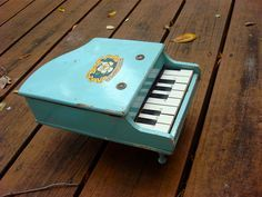Antique Wooden Baby Blue Toy Piano 1950s mine was wooden and beutiful