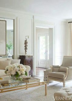 Neutral living room with beautiful wood cabinet.