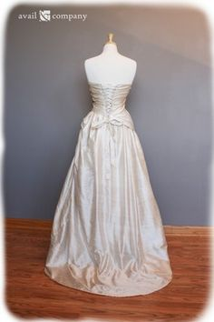 Cherry Blossom Bridal Gown Wedding Dress - Cherry Blossom Style - Avail & Company, LLC  An Informal Vintage Wedding Dress with Pink Floral Embroidery and a Subtle Corset.