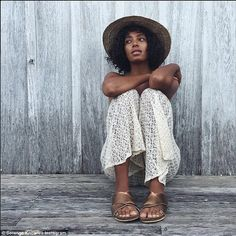Lovely. I really want these sandals. Chilling out: Solange tamed her wild hair with a straw hat as she relaxed in lace trousers and a T-shirt