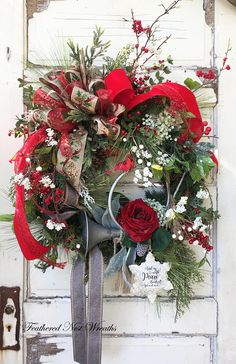 This Elegant Christmas Wreath is made on a Pine Base. I have Layered it with Long Needle Pine, Juniper, Red and White Berries, Faux Boxwood with Red Berries, Small Sparkly Creamy White Flower Heads, Iced Greenery with White Berries and other Christmas Greenery. I Added a French