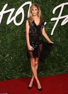 Amazing: Poppy Delevingne wowed on the red carpet in a saucy mesh Topshop dress