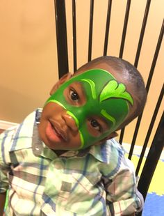 A green PJ mask face painting done from our face painter Niloo.