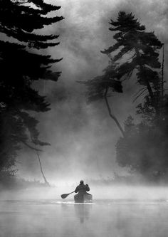 Paddler in the early morning mist. Leslie Frost wilderness area, Ontario, Canada. Photo Peter Bowers, 2007