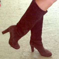 Chocolate brown suede boot These barely worn chocolate brown suede boots are great for all your fall and winter looks.   **they have a small damaged area on the inside of the left heel, you can't see it when they are on and if you didn't know it was there you wouldn't be able to tell Shoes