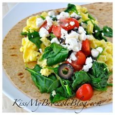 Greek breakfast wrap with spinach, tomatoes, Feta, and black olives