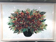 """We created this dynamic fused glass basket of red tone hydrangeas for our client in Cornelius, North Carolina. The dimensions are 18"""" x 30"""". The background is tiny hand-cut mosaic tiles. We also..."""