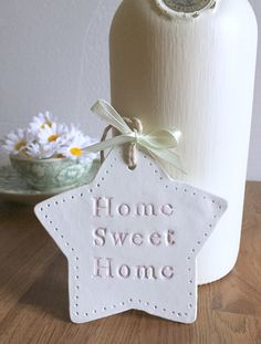 Littlemoos Handmade Clay Star, Housewarming Gift, Gift for friends  This lovely little handmade clay star would make a lovely housewarming Gift that would be a perfect little gift for friends to display in their in their new home decor. The handmade clay plaque has a detailed edge, stamped with 'Home sweet Home' and decorated with twine for hanging and ribbon and letter colouring of your choice. For a personal touch this handmade gift can be personalised with the homeowner's initials…