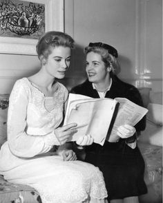 """Mrs. Dorothy R. Randall, executive director of the Eastern Pennsylvania Chapter of the national Multiple Sclerosis Society, shows the script of """"Medic"""" to be given next Monday, to Philadelphia native Grace Kelly."""