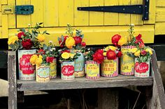 they wrapped all the tin cans with fun sayings personalized for their wedding! yellow.red.teal.