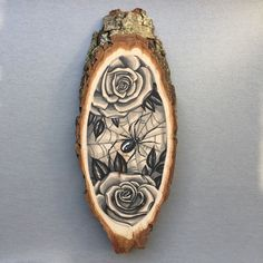 Wood slice with an original drawing of roses and a door Inkspirednl