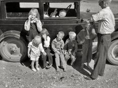 "July 1936. ""Drought refugees from Bowman, North Dakota, in Montana."" En route to Oregon or Washington."
