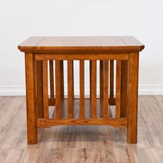 This mission style end table is featured in a solid wood with a light glossy cherry finish. This side table is in great condition with a bottom shelf, carved trim and side panels. Craftsman inspired side table with storage space!     #mission #tables #endtable #sandiegovintage #vintagefurniture