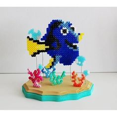 This is a one of a kind Dory inspired piece of art. Made out of individually placed perler beads, this under water scene features Dory, corals, and some bubbles. This would be a great decoration for any Disney fan Perler Beads, Perler Bead Mario, Perler Bead Disney, Fuse Beads, Pearler Bead Patterns, Perler Patterns, Nemo Y Dory, Hama Beads Animals, Art Perle