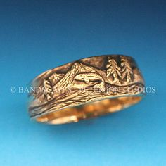 Hey, I found this really awesome Etsy listing at http://www.etsy.com/listing/158377137/gold-trout-fishing-band-in-either-14k