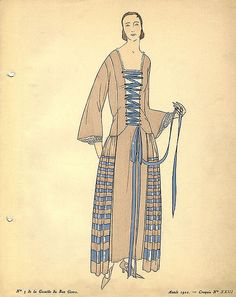 Date: 1922    Description: Brown dress with blue stripes and blue ribbon