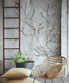 Brighten up your space with a twinkly light wall willow tree.