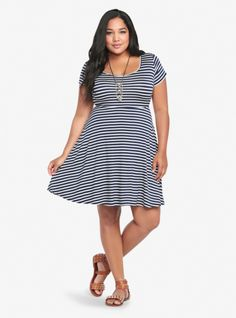 Our popular skater dress gets a lightweight sister in this soft and stretchy slub knit stunner. With nautical navy and white stripes with short sleeves, the playful circle skirt has amazing movement. You'll simply love wearing this not-so-basic beauty.